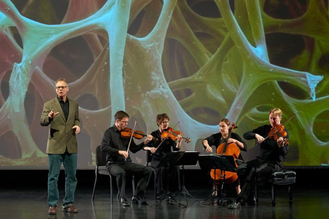 """Robert Davies (standing) and the quartet during a performance of """"The Crossroads Project."""" Musicians include (left to right) Robert Waters, Rebecca McFaul, Anne Francis Bayless and Bradley Ottesen. Andrew McCallister /Courtesy of The Crossroads Project"""