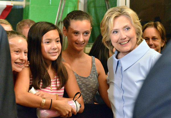 Young ladies with Hillary Clinton in Portland, Maine. Photo by Ramona du Houx
